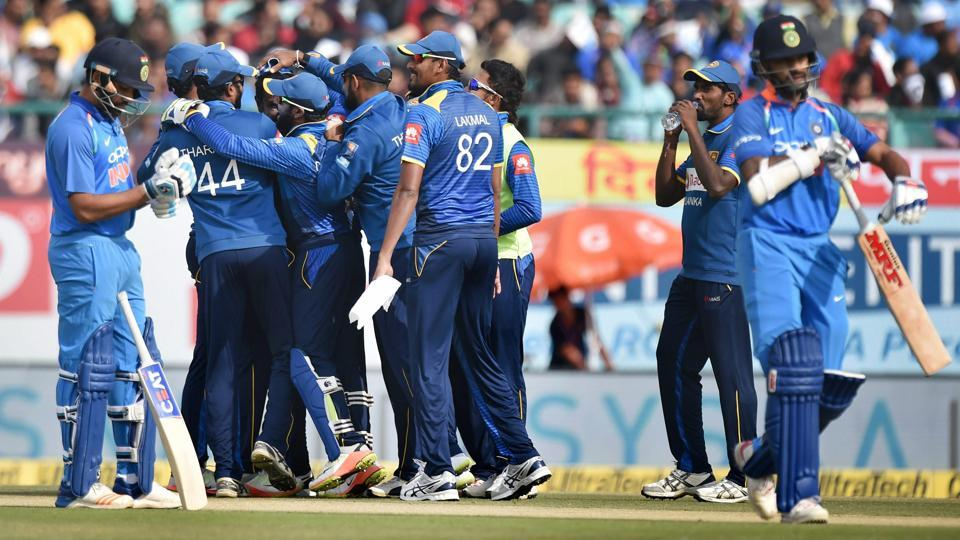 Sri Lanka's Angelo Mathews celebrates the wicket of India's Shikhar Dhawan during the first ODI match in Dharamshala. India recorded the lowest first powerplay score in ODI history.
