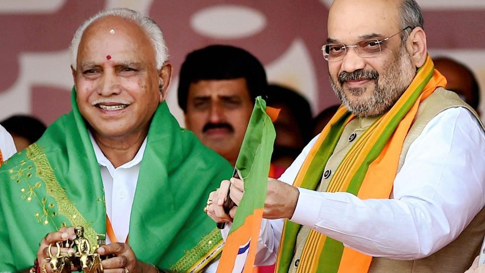 BJP President Amit Shah presenting a party flag and a bullock cart memento to State Unit President BS Yeduyurappa during the launch of party's 75-day 'Nava Karnataka Nirmana Parivartan Yatra' in Bengaluru in November 2017.