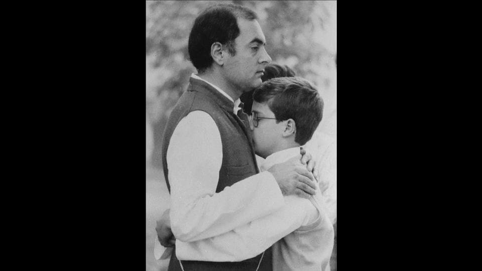 In this November 06, 1986 photo Rahul Gandhi is seen embracing his father Rajiv Gandhi. Rahul was just shy of his 21st birthday when his father was assassinated in Tamil Nadu in 1991. Rahul attended The Doon School in Dehradun, Uttarakhand from 1981 and then joined St Stephen's College in Delhi, before moving abroad for further education. After he finished his M.Phil, he worked at a management consulting firm in London.  (Santosh Gupta / HT ARCHIVES)