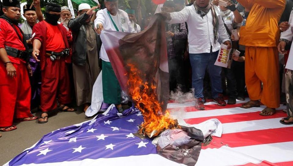 Indonesian Muslim groups burn US, Israeli flags over Trump's