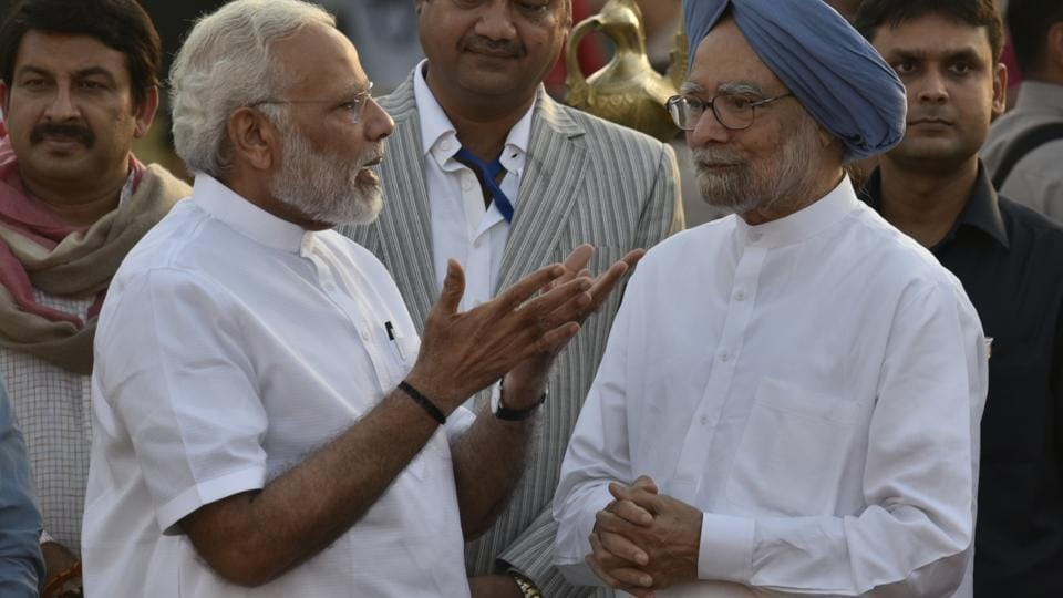 """A file photo of Prime Minister Narendra Modi with his predecessor Manmohan Singh at Dusshera celebrations in New Delhi. On Monday, Singh said he was """"deeply pained and anguished"""" by the """"falsehood and canards"""" being spread to score political points by Modi."""