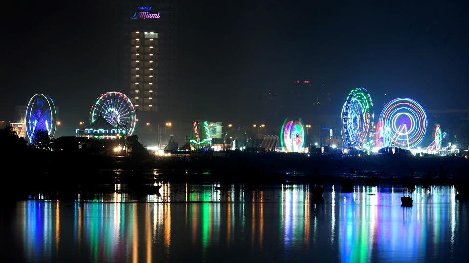 The fair lights up the night sky, as seen from Bandra Reclamation, across the creek. (Shashi S Kashyap/HT PHOTO)
