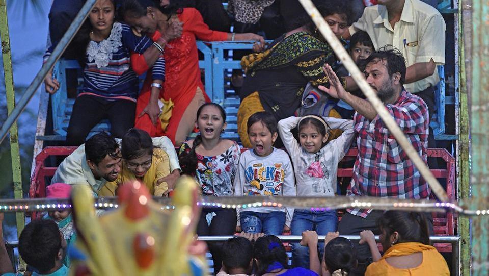 People enjoy a toy boat ride at the fair. (Shashi S Kashyap/HT PHOTO)