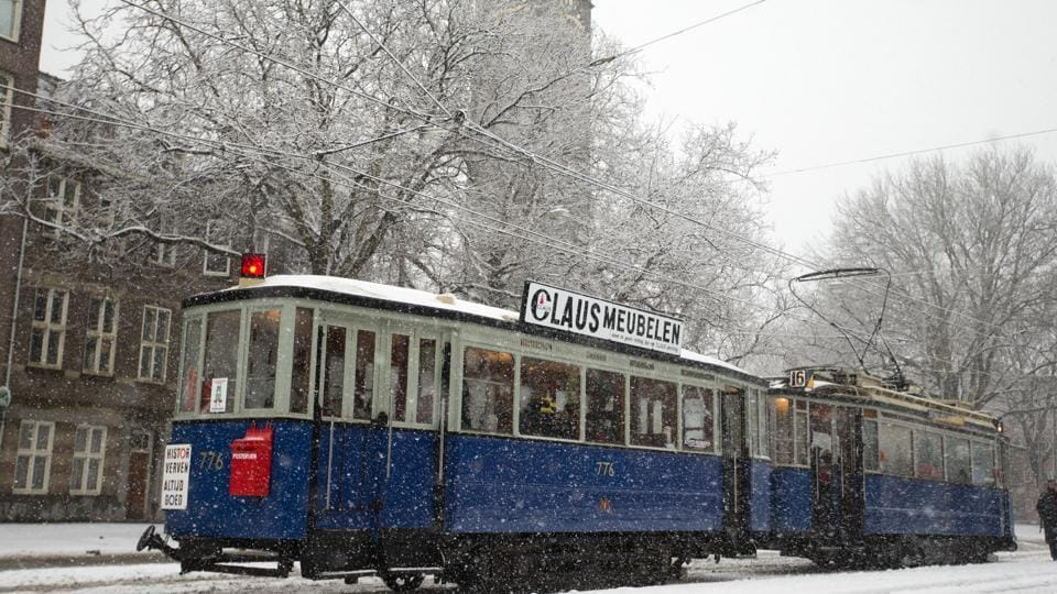 People wait to board a historic tram as snow falls in Amsterdam, Netherlands, on Sunday.