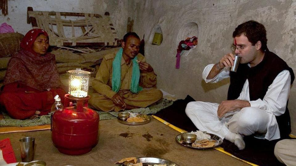Rahul Gandhi is seen having dinner with a family in Jhansi on December 23, 2009. The first test of Rahul's political mettle came in 2009, when he campaigned during Uttar Pradesh elections. The Congress, which had been struggling in the state, won 22 out of 80 seats, its best show in years. But this victory was short-lived. He could not land Congress a victory in the state in the 2010 state elections. (PTI)