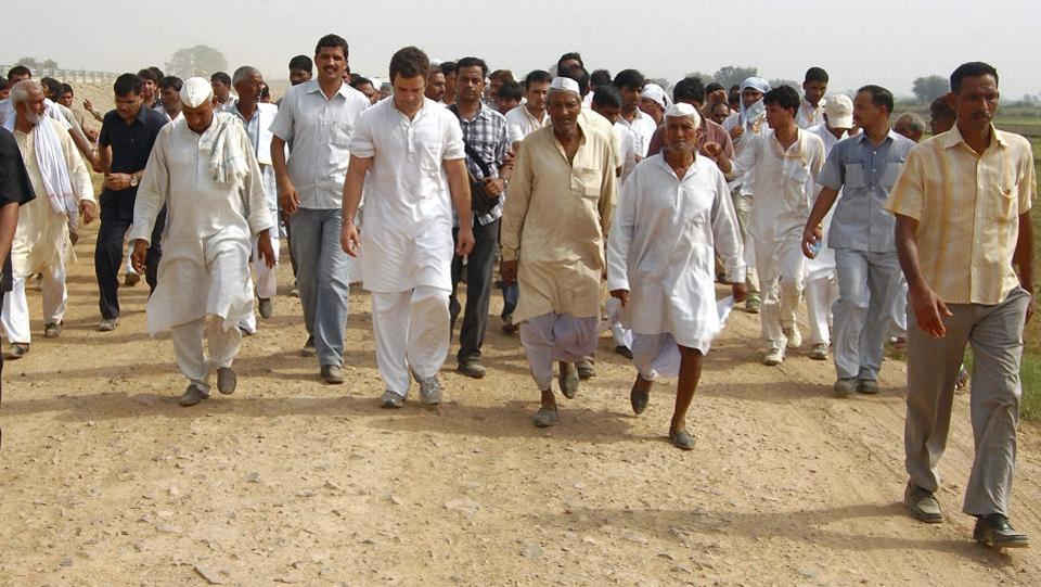 Congress General Secretary Rahul Gandhi during his 2011 protest march against the Mayawati government from Bhatta Parsual to Aligarh. In 2011, Rahul made national headlines when he took on the Mayawati government during the anti-land acquisition protests by farmers in Bhatta Parsaul. Gandhi dodged the police to enter the village, riding pillion on a farmer's motorbike, and was arrested by the administration. (PTI)