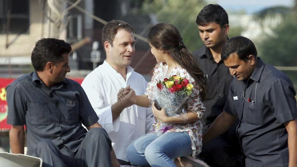 Congress vice-president Rahul Gandhi being greeted by a young supporter during his road show in Bharuch, Gujarat in 2017. Gandhi's astute use of his Twitter account, laced with humour and sarcasm, challenged Modi government's policies such as demonetisation and GST and increased his social media following. (PTI)