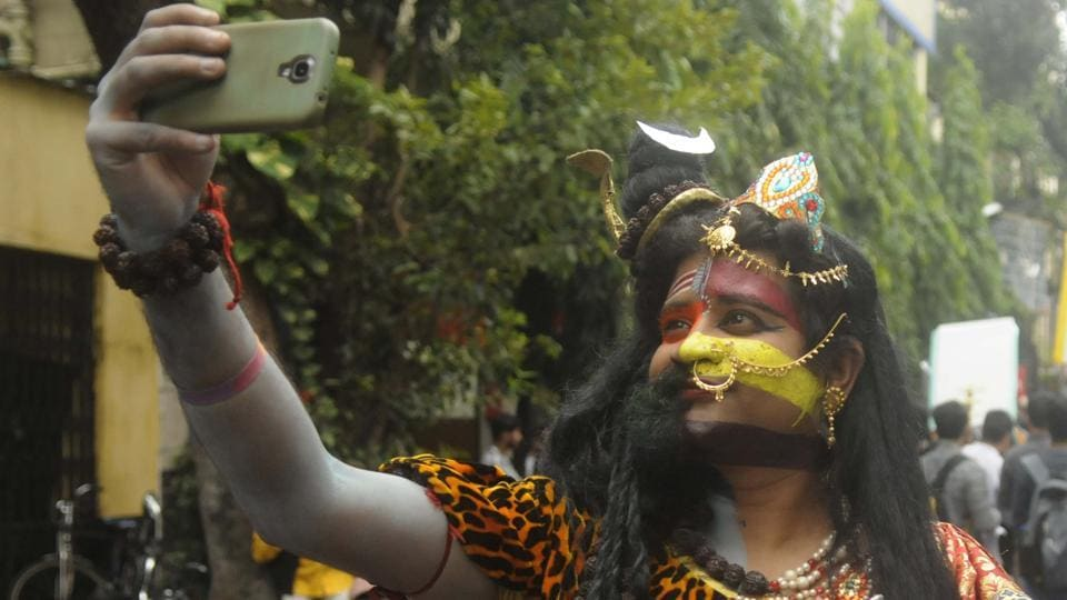 A participant  dressed as Shiva-Parvati takes a selfie during the 16th Rainbow pride walk in Kolkata. The organisers claimed that the march witnessed its highest ever turnout this year. (Samir Jana / HT PHOTO)