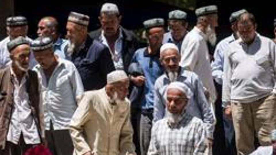 File photo taken on June 23, 2017 shows local Muslims leaving a mosque after Friday prayers in Hotan, in China's Xinjiang Uyghur Autonomous Region. Increasingly strict curbs imposed on the mostly Muslim Uyghur population have stifled life in the tense Xinjiang region, where beards are partially banned and no one is allowed to pray in public.