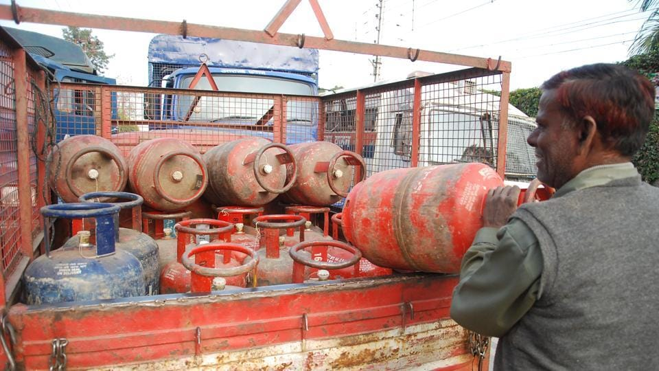 A gas agency employee with the LPG cylinders.