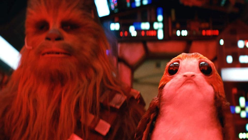 Star Wars: The Last Jedi L to R: Chewbacca and a Porg.