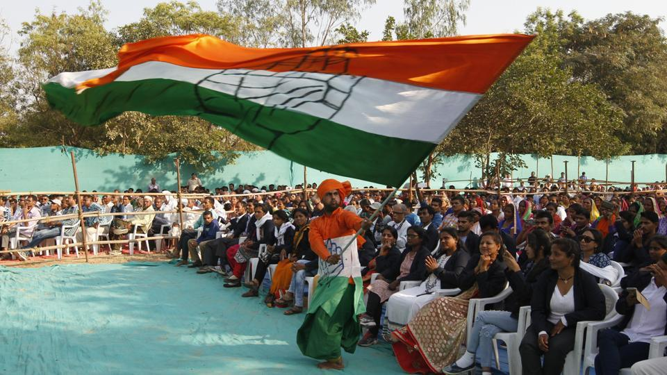 A man waves a Congress flag at a rally in Gujarat.