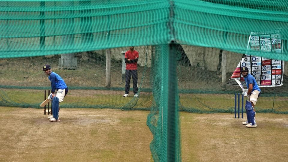 Indian cricket team stand-in captain Rohit Sharma and MS Dhoni (left) bat at the nets in Mohali on Tuesday.  (PTI)