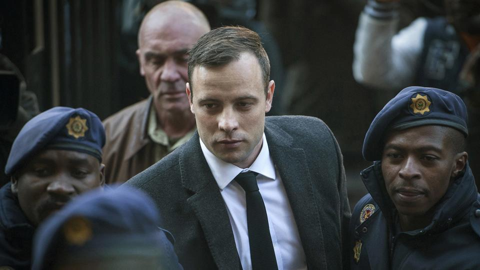 Oscar Pistorius (C )arrives at the High Court in Pretoria, South Africa, for a sentencing hearing for the murder of his girlfriend Reeva Steenkamp in his home on Valentine's Day 2013.