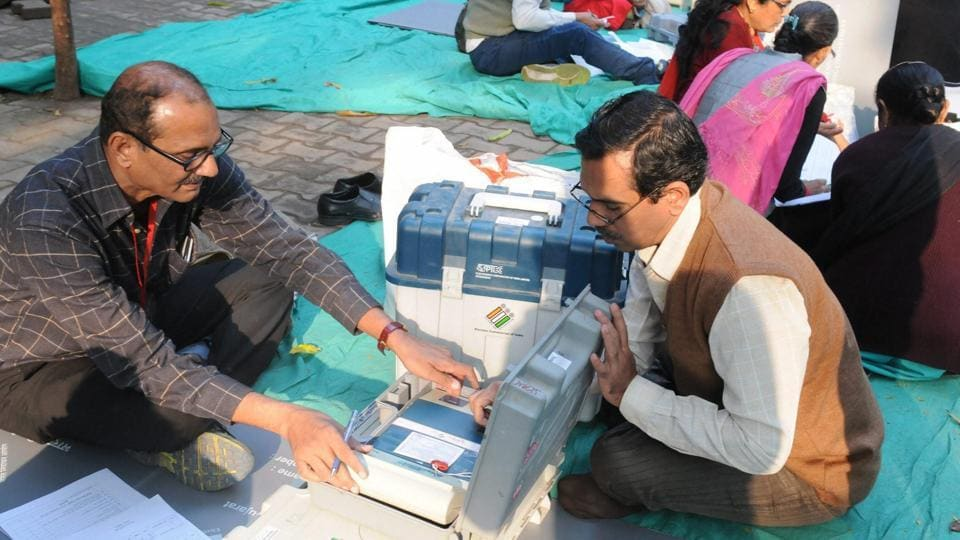 Polling officials checking the electronic voting machines (EVMs) in Surat on Friday on the eve of the first phase of the Gujarat Assembly election.