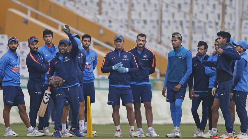 Indian cricket team players listen to their fielding coach, Ramakrishnan Sridhar (fourth from left), during the practice session in Mohali on Tuesday. (AP)