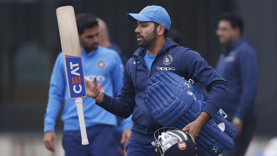 Indian cricket team stand-in skipper Rohit Sharma juggles his bat as he walks for a nets session ahead of the second ODI against Sri Lanka cricket team in Mohali. (AP)