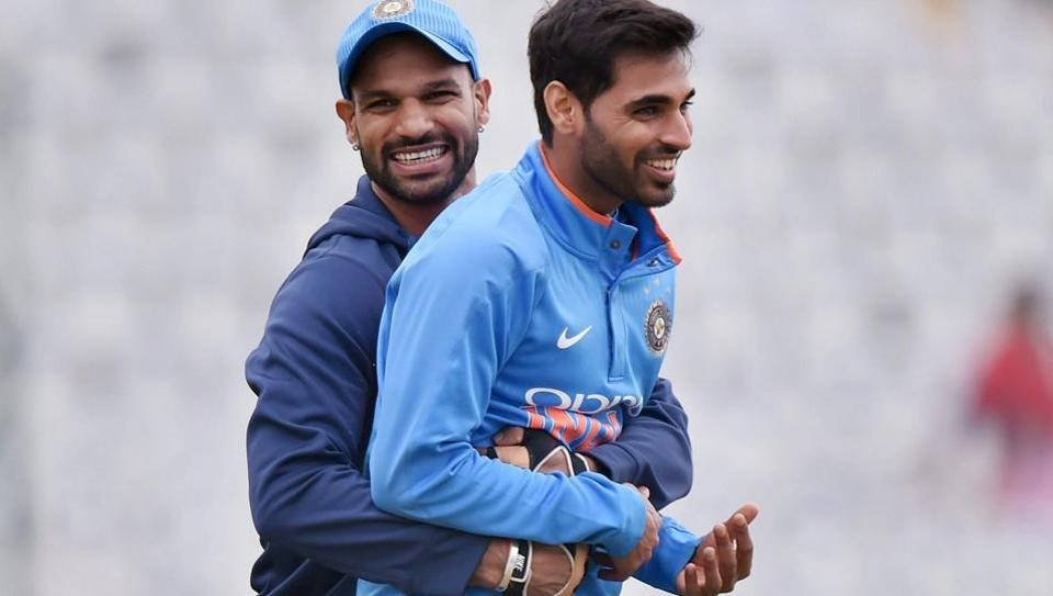 Indian cricket team's Shikhar Dhawan and Bhuvneshwar Kumar share a light moment during a practice session on the eve of the second ODI against Sri Lanka cricket team in Mohali.  (PTI)