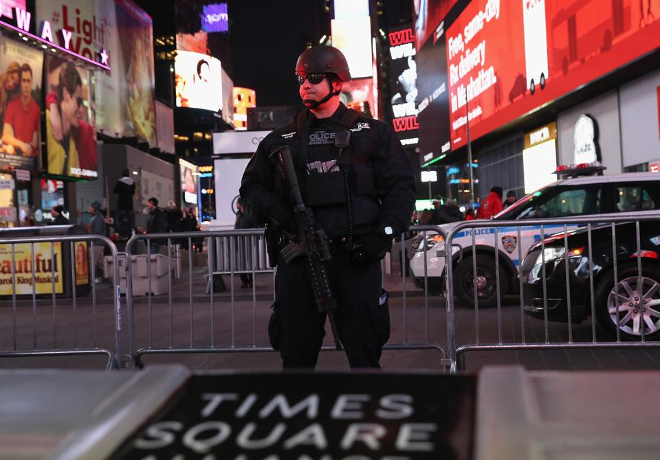 A policeman stands guard in Times Square not far from the site of a pipe bomb explosion on December 11, 2017 in New York City.