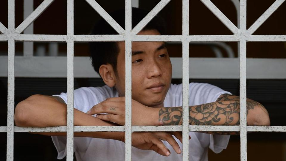 An inmate looks out from behind bars during an initial period of cold turkey withdrawal, inside a drug rehabilitation centre in Hai Phong, Vietnam. During years of compulsory rehab in Vietnam, addicts spend days in a range of activities as part of what authorities call 'work therapy'. But critics say the work of tens of thousands addicts is tantamount to forced labour that rarely helps users extinguish their addiction. (AFP)