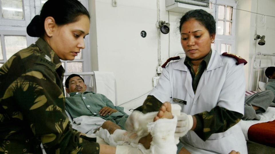 An Indian Army soldier gets treatment for a gunshot wound to his leg at the 92 Base Military hospital, Srinagar,  June 15,2002