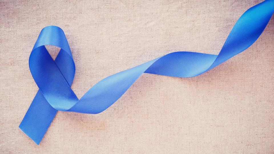 Blue ribbon signifying  colorectal cancer.
