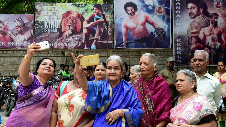 Women from an old age home wait outside a theatre in Bengaluru before watching the opening show of Bahubali 2: The Conclusion. Bahubali 2 was the India's most searched query on Google in 2017.