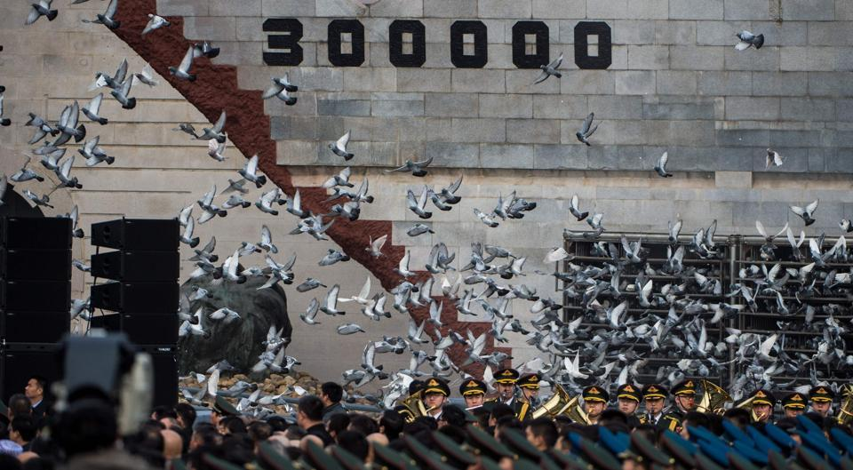 Doves are released during a memorial ceremony at the Nanjing Massacre Memorial Hall in Nanjing.