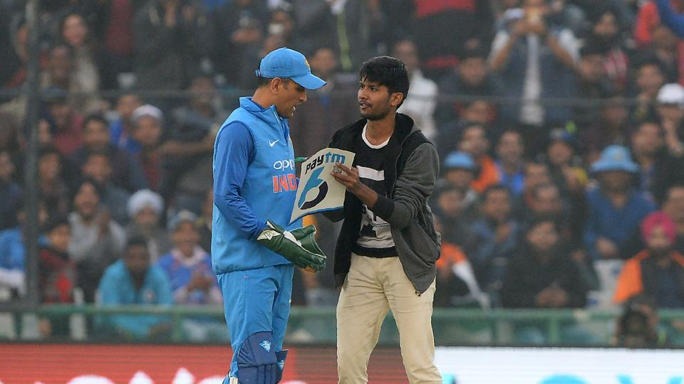 An Indian cricket fan approached MS Dhoni during the second One Day International (ODI) cricket match between India and Sri Lanka at Mohali. (AFP)