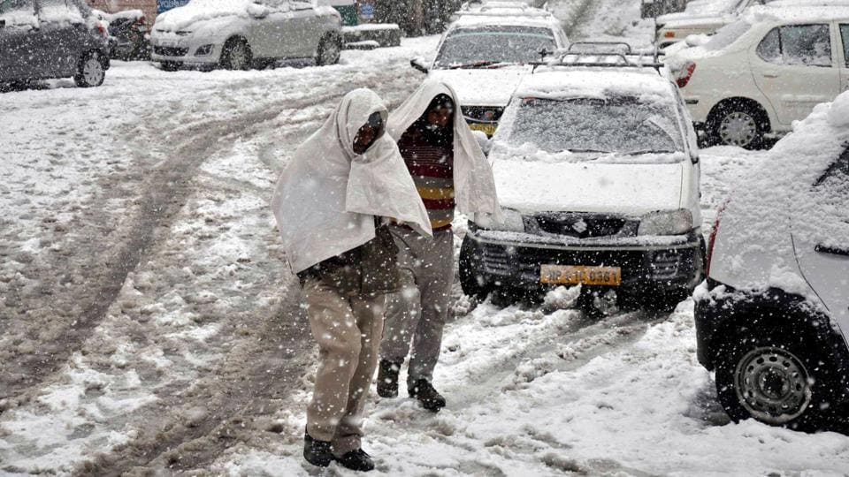 Snowfall was also recorded in Bharmaur in Chamba district, Solang Valley in Manali district and Keylong in Lahaul-Spiti district. People walk through fresh snow at Khajjiar road, Dalhousie in Chamba district. (HT Photo)