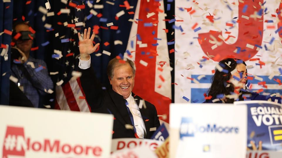 Democratic US Senator-elect Doug Jones greets supporters during his election night gathering at the Sheraton Hotel on Tuesday in Birmingham, Alabama.