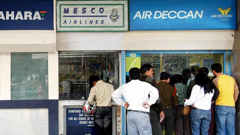 People queue up at an Air Deccan counter outside the Delhi airport in February 2006. The airline, which merged with Kingfisher Airlines, was grounded in 2012 due to Kingfisher's financial troubles.