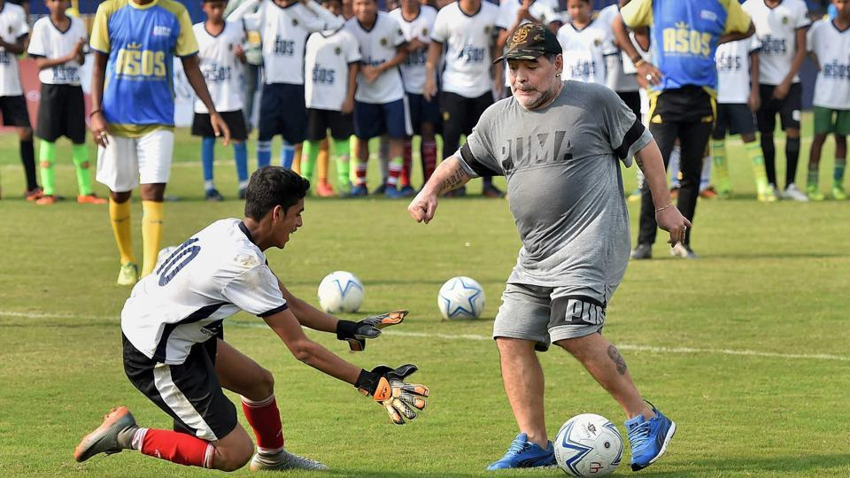 Diego Maradona shows his skills during a football workshop at Barasat, West Bengal, on Tuesday. (PTI)