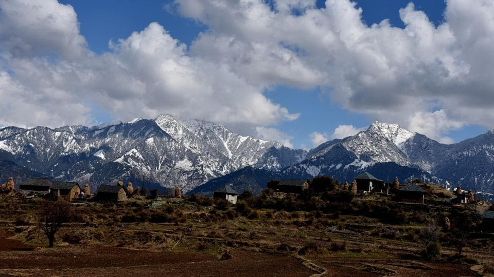 Mandi hills in Himachal Pradesh were also wrapped in fresh snow lending sharp contrast to the lower regions. The high-altitude tribal areas, mountain passes, ranges and other higher hills experienced heavy snowfall, mid and lower areas received widespread rains. (Birbal Sharma / HT Photo)