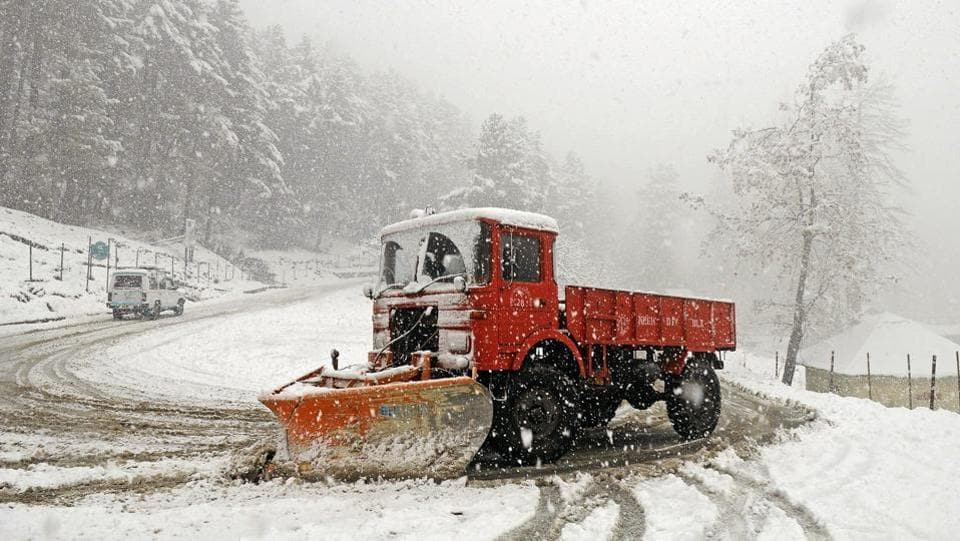 A snow cutter machine cleans out the Gulmarg-Tangmarg highway in Srinagar. Minimum temperatures throughout the Kashmir Valley and Ladakh region remained below freezing point on Wednesday and the ski resort of Gulmarg recorded the coldest temperature at minus 9.8. (Waseem Andrabi / HT Photo)