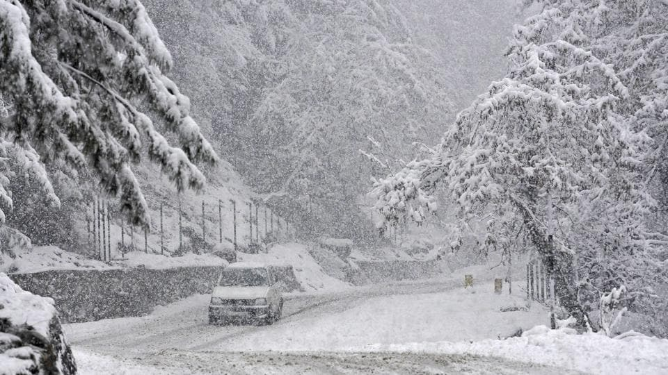 A car drives past the scenic beauty of Gulmarg-Tangmarg road. The nearly 300-km long Jammu-Srinagar National Highway, the only all weather road linking Kashmir with the rest of the country, remained closed for the third consecutive day on Wednesday due to multiple landslides in Ramban district, a traffic official said. (Waseem Andrabi / HT Photo)