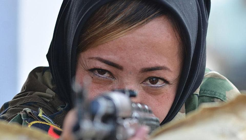 An Afghan army cadet fires at a target during a practice session at the Officers Training Academy (OTA) in Chennai. A group of 20 Afghan army women serving in combat roles are in Chennai for a military training programme, the first such exercise which has enthused their peers in India, also keen to serve in combat on the front-line. (AFP)