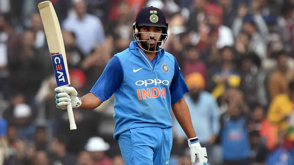 Rohit Sharma celebrates his century during the second ODI between India and Sri Lanka in Mohali.