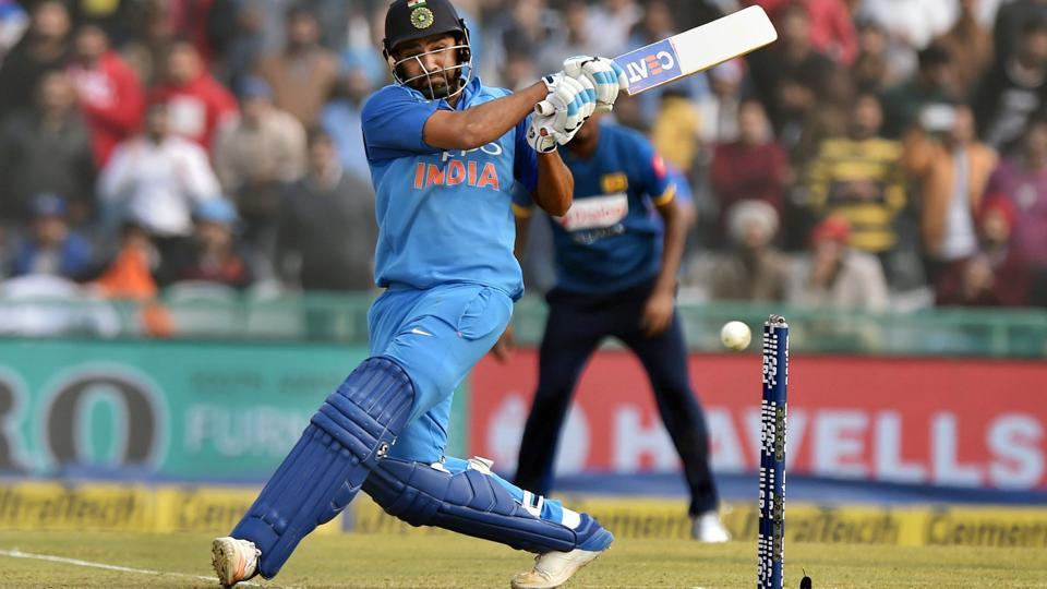 Indian cricket team captain Rohit Sharma hits a maximum during his double ton against Sri Lanka cricket team in the second ODI in at the PCA Stadium in Mohali on Wednesday.