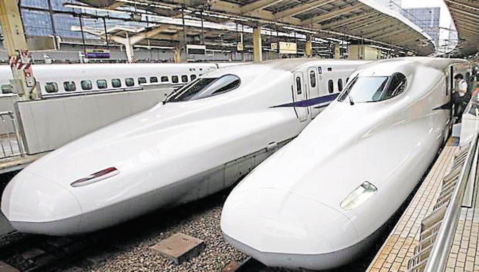 Passengers get on the Shinkansen high-speed train at Tokyo station.