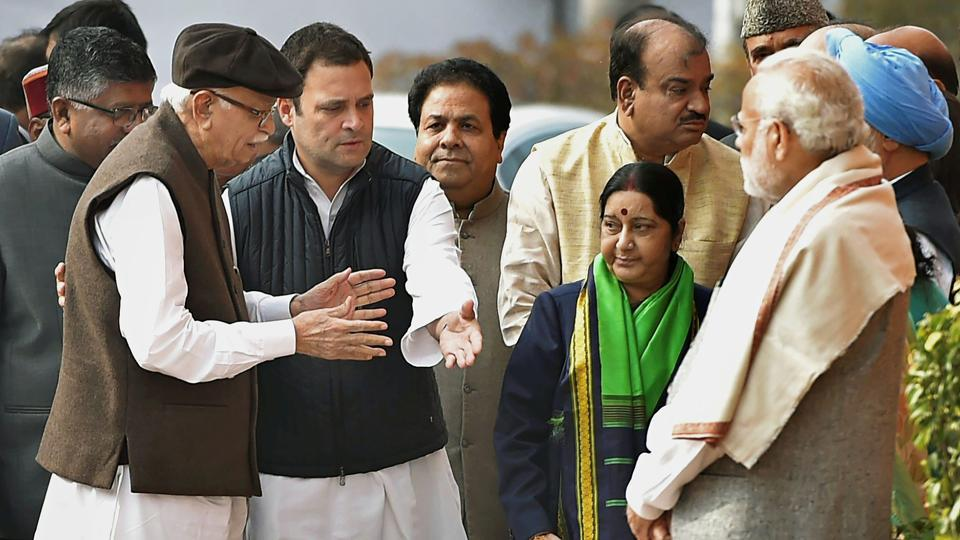 Congress president-elect Rahul Gandhi greets BJP veteran LK Advani ahead of a memorial ceremony for martyrs of the 2001 Parliament attack in New Delhi on Wednesday.