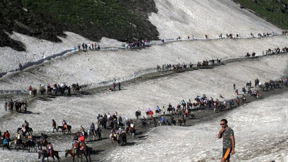 File photo of pilgrims crossing mountain trails during their journey to the Amarnath cave on the Baltal route from Srinagar earlier this year.