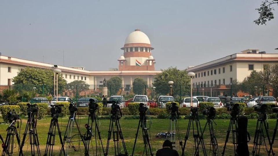 Television journalists set their cameras inside the premises of the Supreme Court in New Delhi.