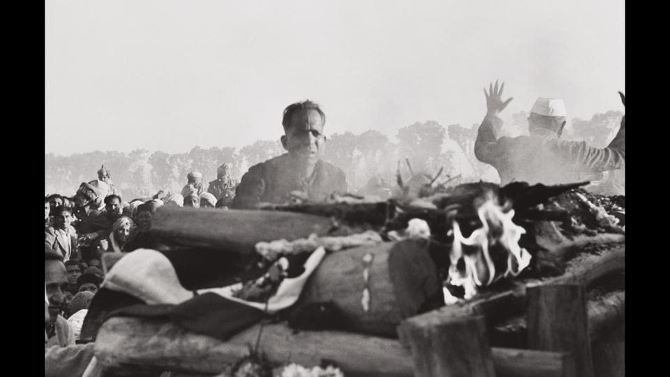 Gandhi's secretary watches the first flames of the funeral pyre, Delhi, India, 1948. Only 90 minutes after Henri Cartier-Bresson and Mahatma Gandhi's meeting on January 30, Gandhi was assassinated, and Cartier-Bresson became a witness to history. (Henri Cartier-Bresson / Magnum Photos)
