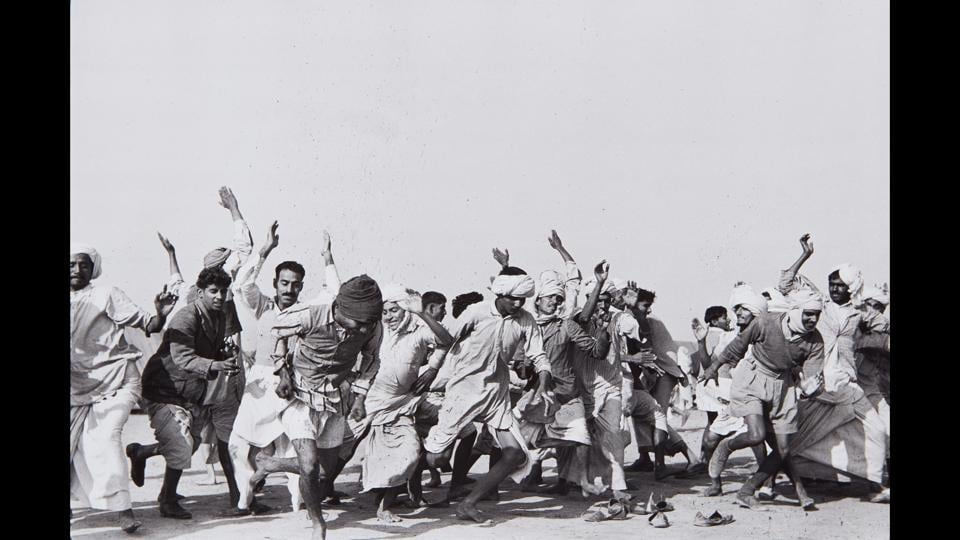 "Games in a refugee camp at Kurukshetra, Punjab, India, 1947. ""There is idleness and despair where people are gathered without homes. At the Kurukshetra camp, they were given simple gymnastics to distract them, to work off their energies,"" wrote Cartier-Bresson. (Henri Cartier-Bresson / Magnum Photos)"