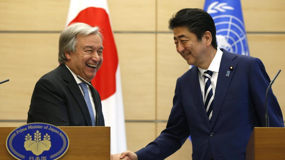 UN Secretary-General Antonio Guterres and Japanese PM Shinzo Abe shake hands during their joint news conference in Tokyo on Thursday.