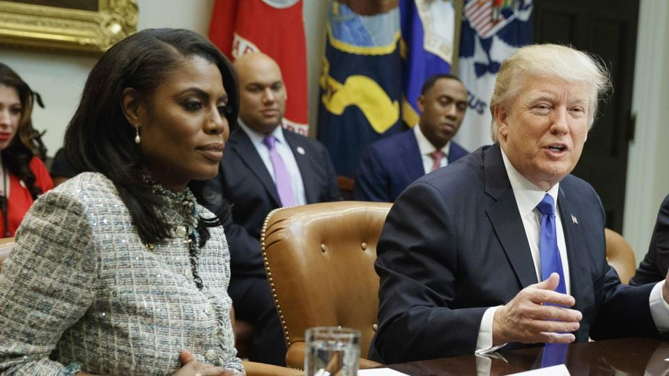 File photo shows Omarosa Manigault Newman with President Donald Trump during a meeting on African American History Month in the White House in Washington.