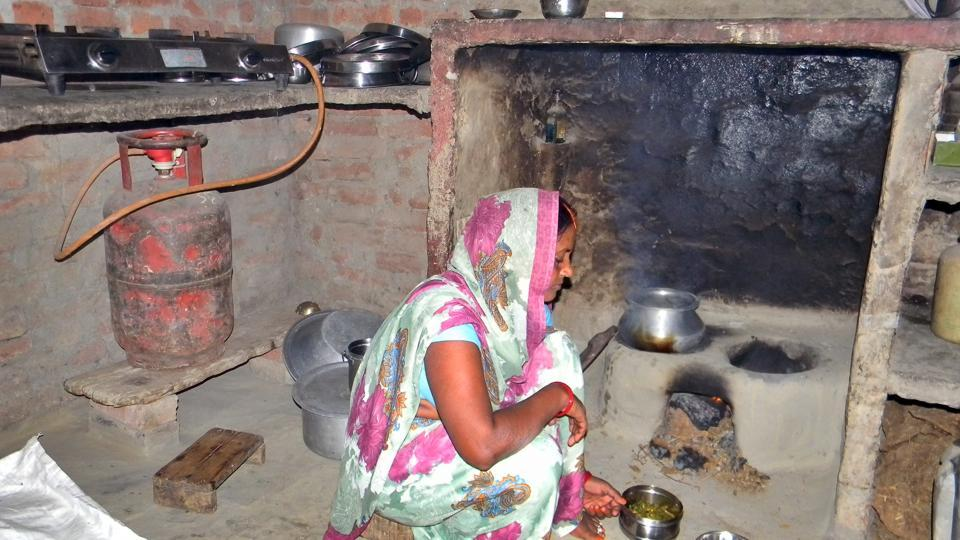 Guddi Devi of Jigni Khas village in Ballia district of Uttar Pradesh now uses the gas stove sparingly to save fuel, for quick snacks or tea for guests but not for daily cooking. (Arvind Gupta/HT Photo)