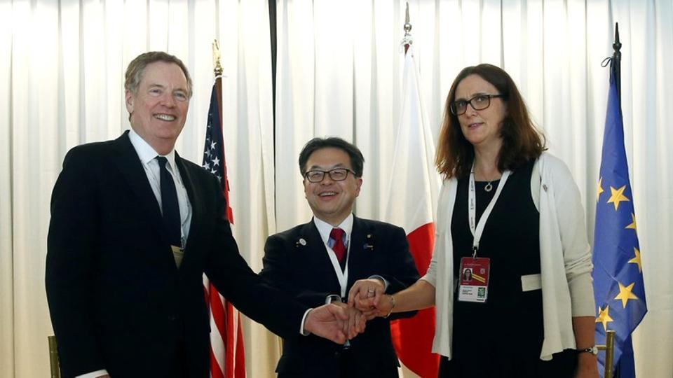 US trade representative Robert Lighthizer (L), Japan's minister of economy, trade and industry Hiroshige Seko (C) and European commissioner for trade Cecilia Malmstrom during a meeting at the 11th World Trade Organization's ministerial conference in Buenos Aires, Argentina, on Wednesday.