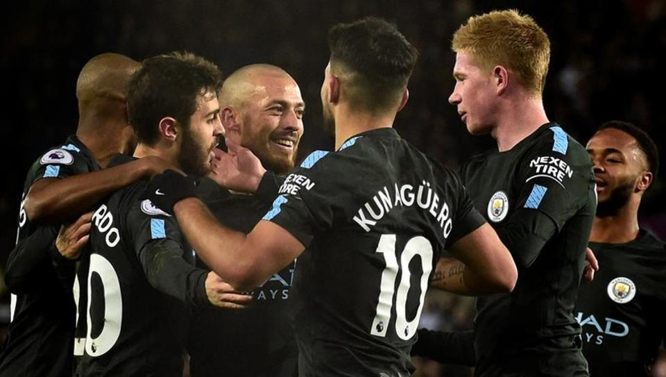 Manchester City's David Silva celebrates scoring their first goal vs Swansea City at the Liberty City Stadium in Swansea with teammates.